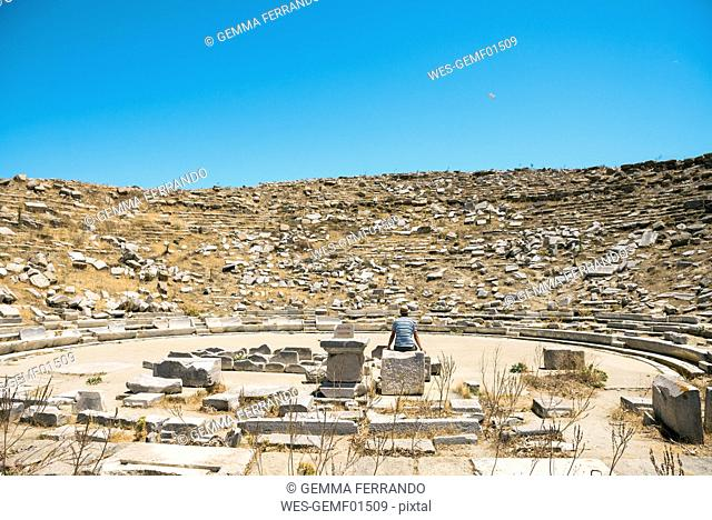 Greece, Mykonos, Delos, tourist visiting the Theatre