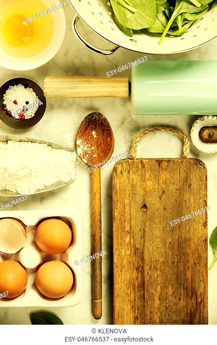 Top view on cooking ingredients and vintage kitchen accessories