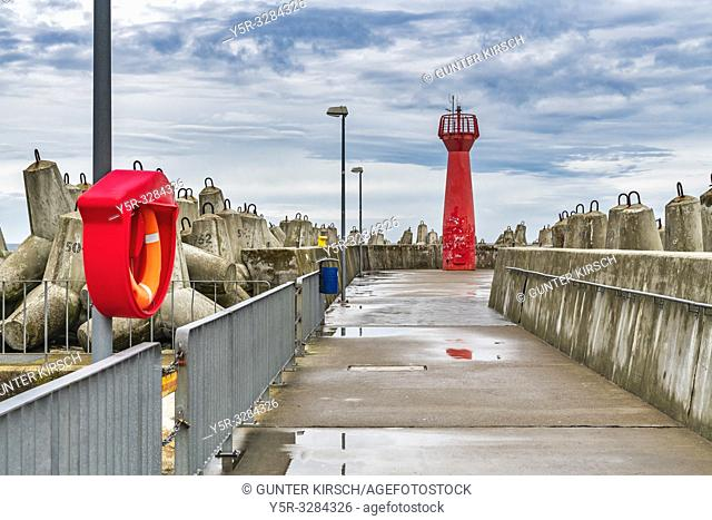 The Red Lighthouse is a so-called pier light and marks the entrance to the harbor of Kolobrzeg, West Pomerania, Poland, Europe