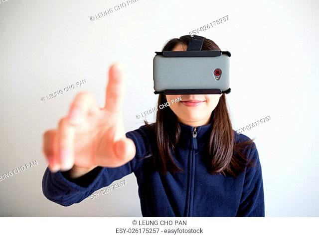 Woman look though vr device and touch on air