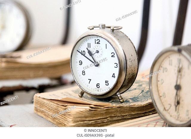 Alarm clock on weathered books