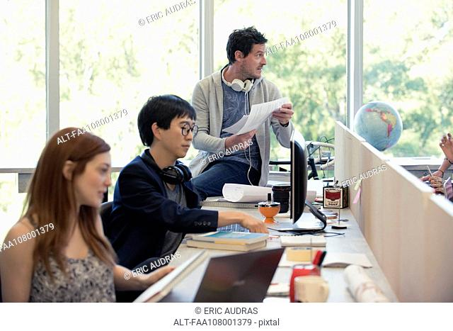 Professionals working in shared office