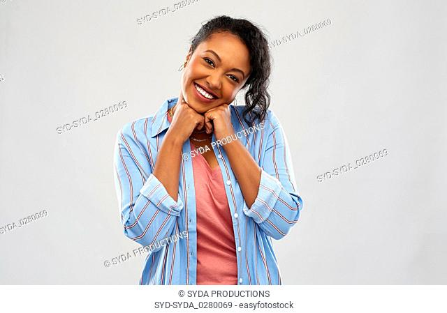 cute african american woman over grey background