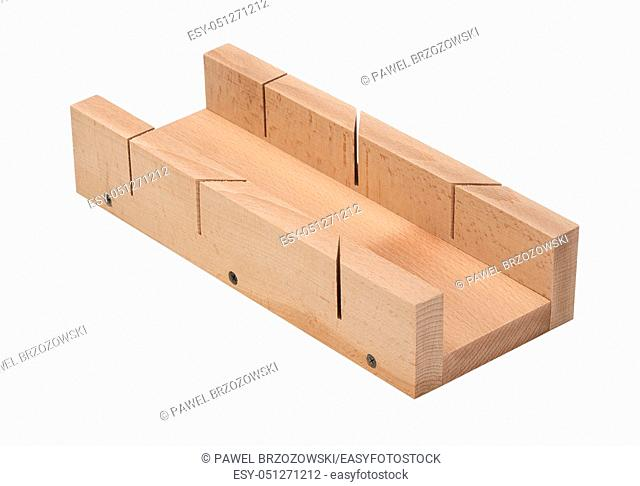 Wooden miter box on white background. Miter box for cutting wood. Woodworking tools for angle cut