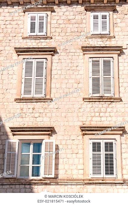 Framed ancient windows with shutters