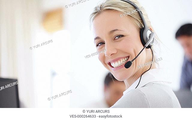 Beautiful customer support employee smiling happily at the camera
