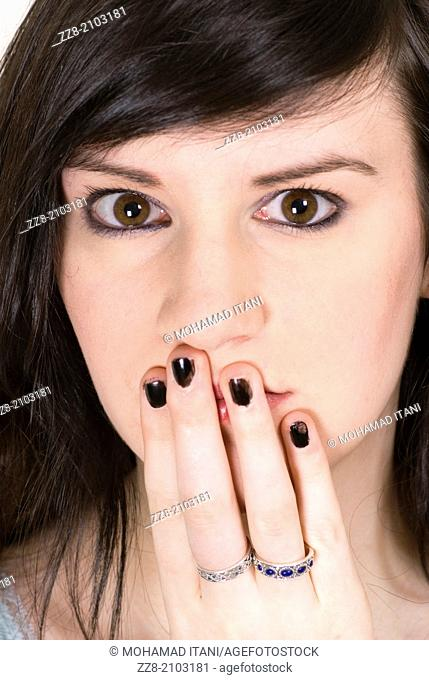 Young woman hand covering mouth