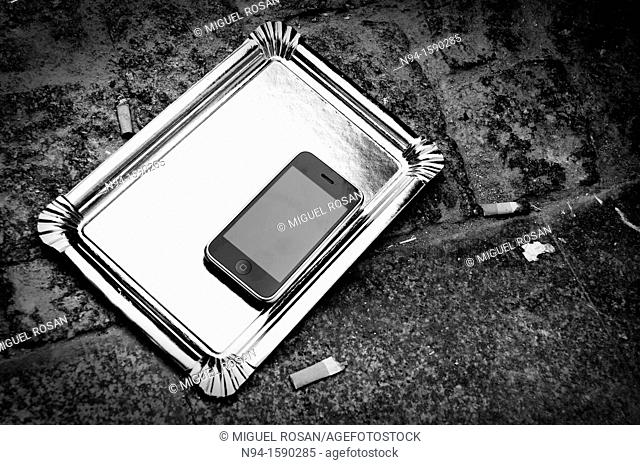 Still life of iPhone 3G on a tray on the floor