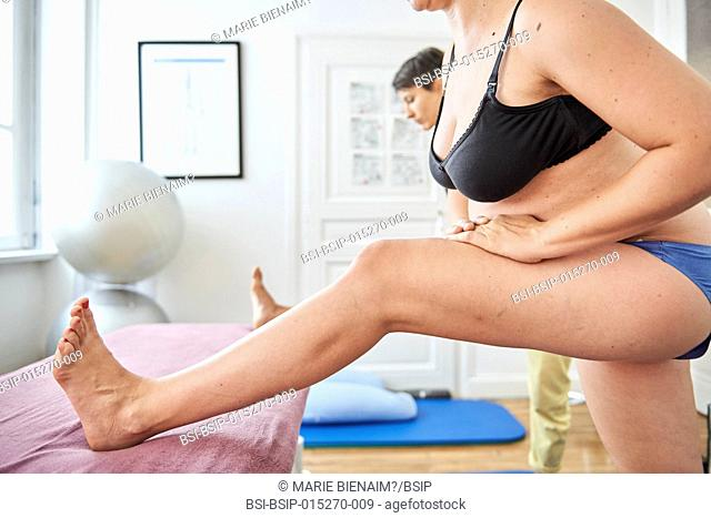 Reportage in a physiotherapy practice in Lyon, France. The physiotherapist teaches a pregnant woman exercises to strengthen her perineum in order to maintain...