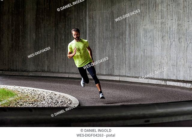 Man running on a street in a curve