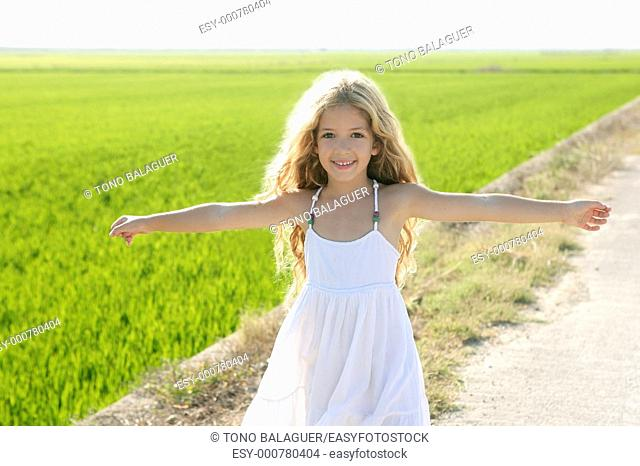 open arms little happy girl green meadow rice field track