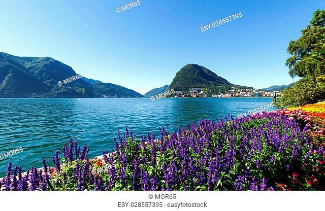 Lugano, Switzerland - Juli 31, 2014: Images of the Gulf of Lugano and Ciani park, botanical park of the city
