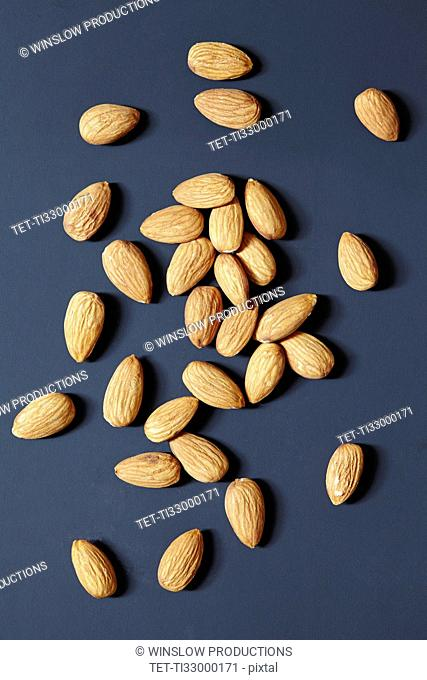 Almonds on black background