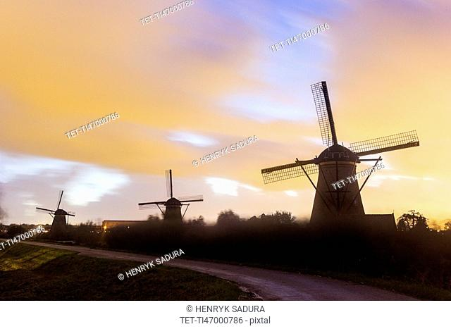 Traditional windmills at sunset