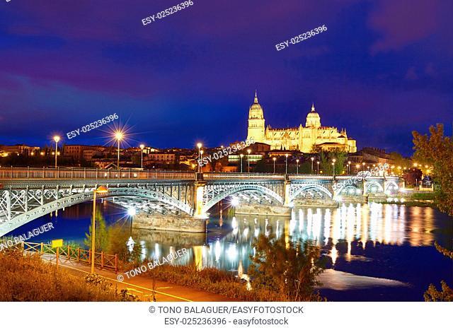 Salamanca skyline sunset in Enrique Estevan bridge over Tormes river in Spain