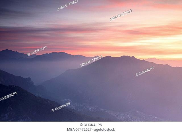 Overview of Valsassina at sunrise from Monte Coltignone, Lecco, Lombardy, Italy