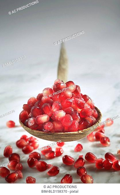 Close up of pomegranate seeds in spoon