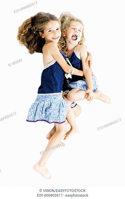 caucasian little girl cheer up hug sister isolated studio on white background