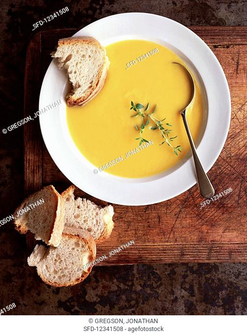 Pumpkin soup with bread and thyme