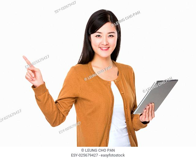 Asian young woman use of tablet pc and finger point up
