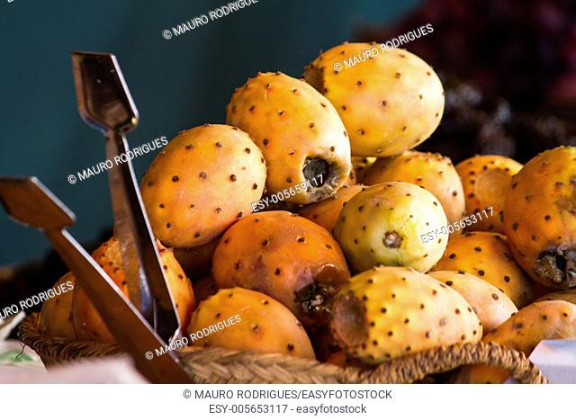 Close up view of a pile of mature prickly pears at sale on a market