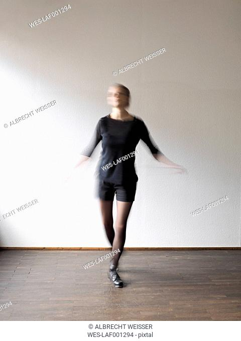 Young woman step dancing