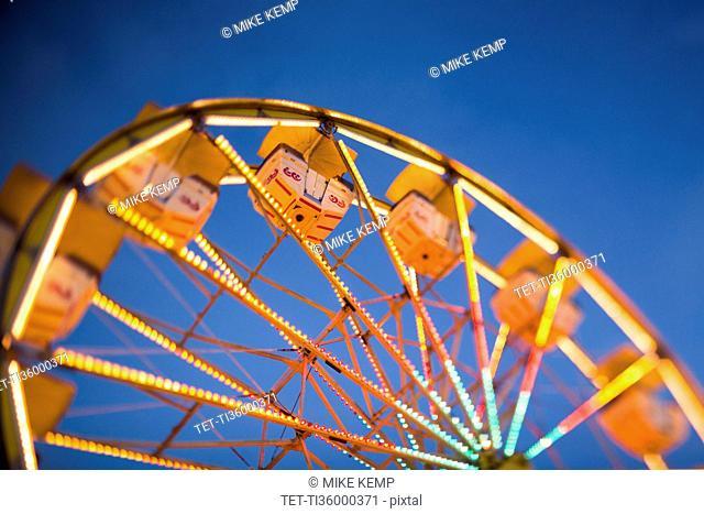 Ferris wheel in amusement park at dusk