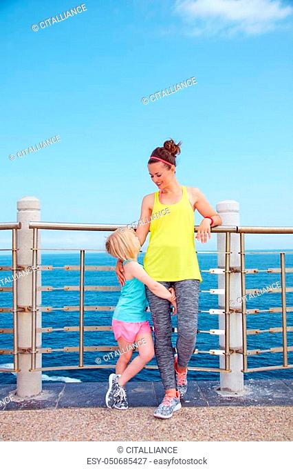 Look Good, Feel great! Full length portrait of happy mother and child in fitness outfit standing on embankment