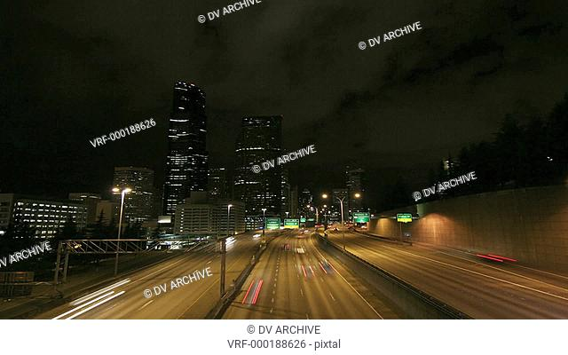 A beautiful shot of time lapsed freeway traffic in a downtown area