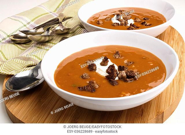 irish beef soup with sour cream in a deep plate