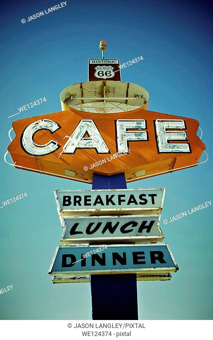 Cafe sign along historic Route 66 in Arizona. Vintage Processing