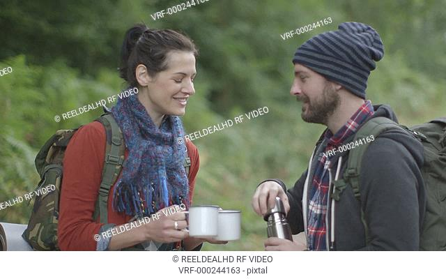 Couple drinking water in forest area