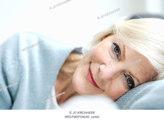Portrait of smiling senior woman, close-up