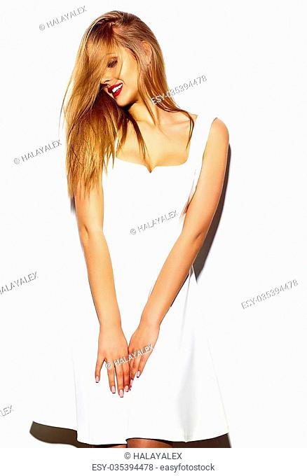 High fashion look.glamor sexy stylish blond young woman model with bright makeup with perfect sunbathed clean skin in white summer dress with red lips