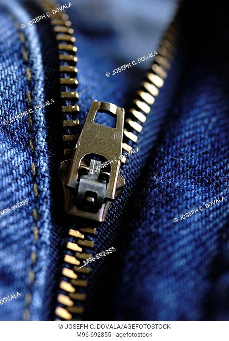 Partialy zipped zipper on blue jeans