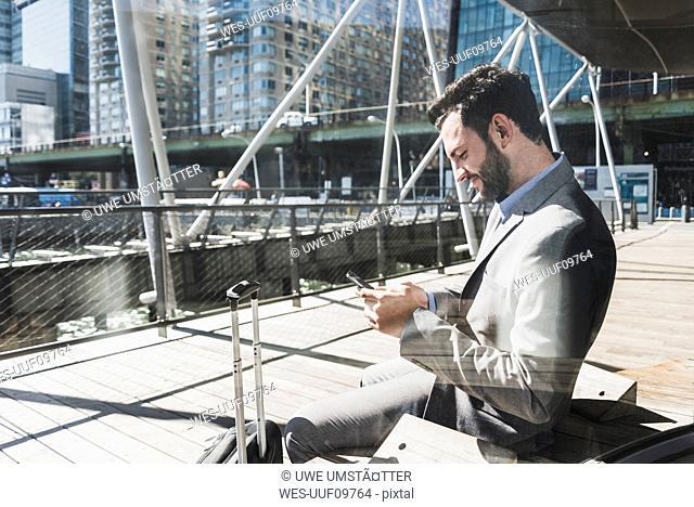 USA, New York, businessman using cell phone