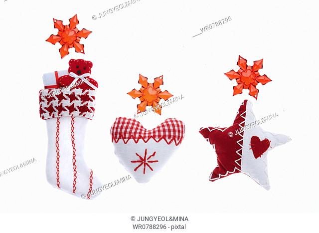 The quilted Christmas stocking, heart, star decorations with red snowflake around
