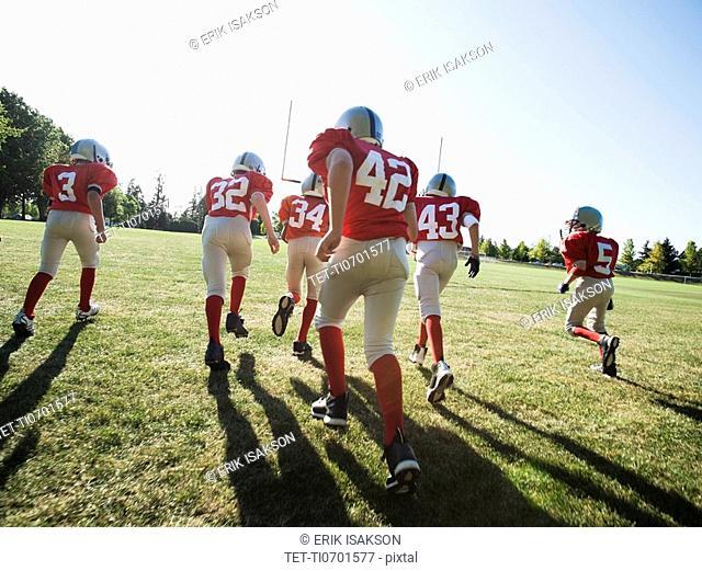 Football players running onto field