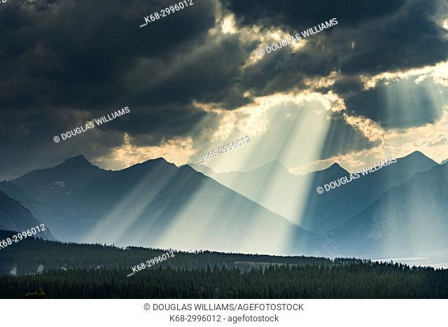 sun, clouds and mountains in Waterton Lakes National Park, Alberta, Canada
