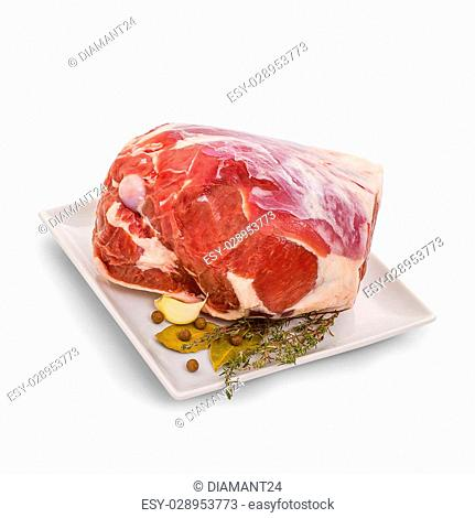 Frozen lamb leg with bone, spices, isolated on white
