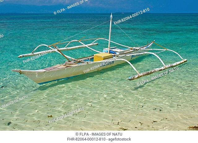 Outrigger fishing boat floating in sea, Honda Bay, Palawan, Philippines, march