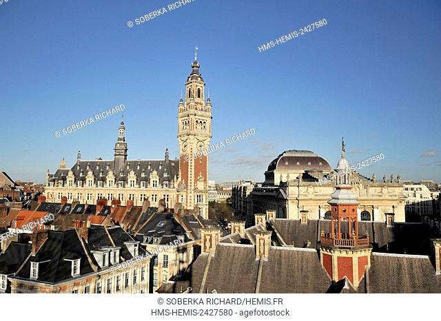 France, Nord, Lille, belfry of the Chamber of Commerce and Industry seen from the big wheel set up for Christmas