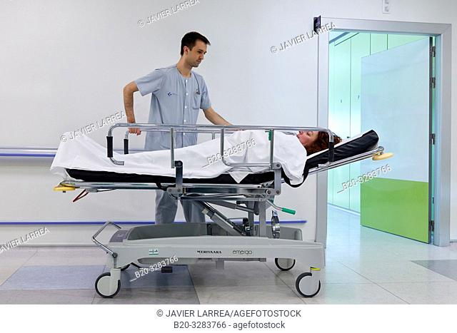 Keeper carrying a patient on a stretcher, Hospitalization Plant, Hospital Donostia, San Sebastian, Gipuzkoa, Basque Country, Spain