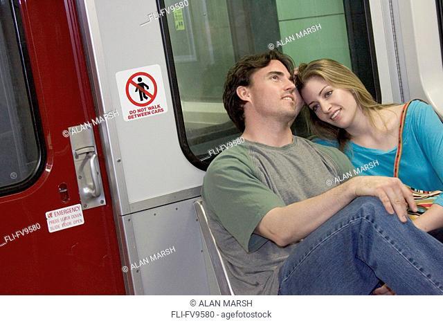Young Couple Riding Subway, Toronto, Ontario