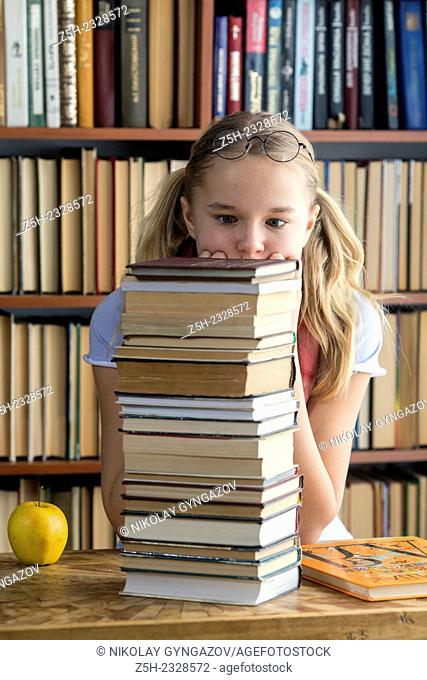 The girl with green apple and a book