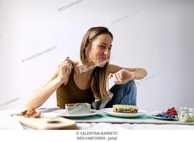 Woman preparing vegan matcha cake