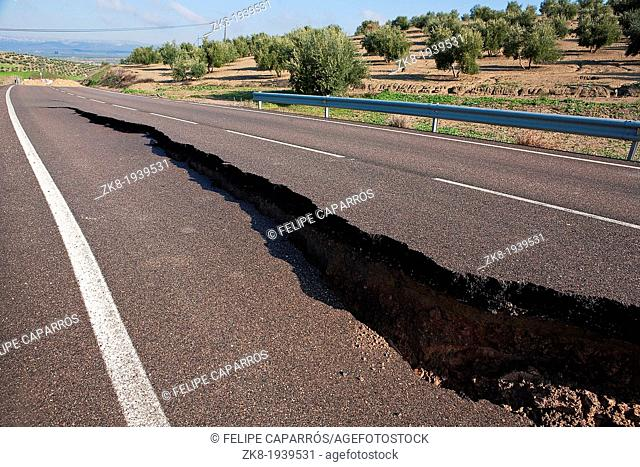 Asphalt road with a crack caused by landslides, Jaen, autonomous community of Andalusia, Spain