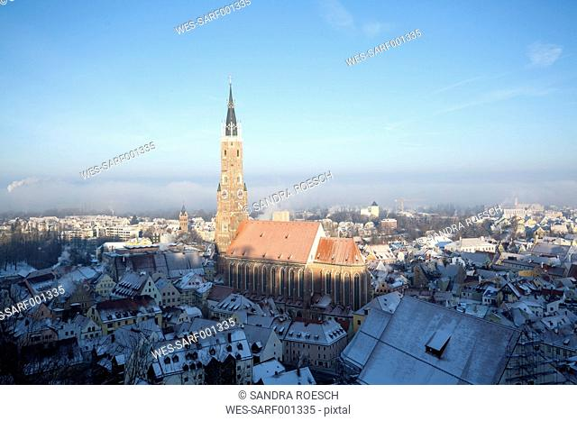 Germany, Bavaria, Landshut, cityscape with St. Martin's church in winter