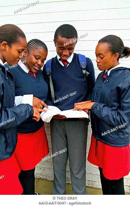 School children reading outside classroom, St Mark's School, Mbabane, Hhohho, Kingdom of Swaziland