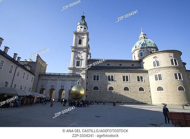 SALZBURG AUSTRIA ON APRIL 17, 2019: Historic town of Salzburg with Man on the Golden Ball in Kapitelplatz (Chapter Square)